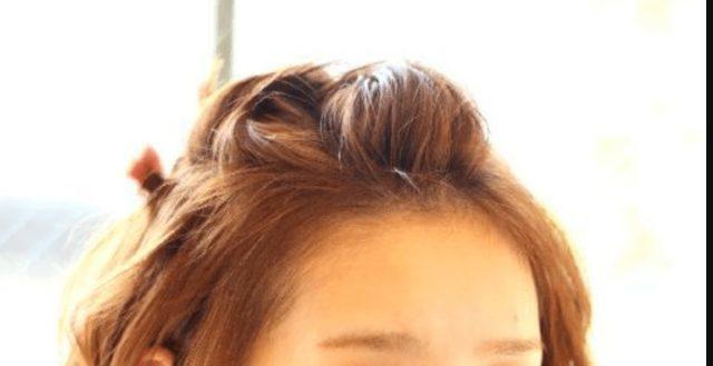 ポンパドールヘアーの女性画像
